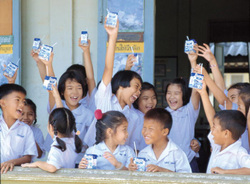"The Swedish corporation Tetra Pak dominates the global market for pasteurised milk packaging, and encourages the consumption of  packaged and processed milk by sponsoring school milk programmes such as  this one in Thailand. It also has a large corporate division, known as DeLaval, that ""develops, manufactures and markets equipment and complete systems for milk production and animal husbandry"" in more than 100 countries. In Pakistan, DeLaval is implementing a ""Dairy Hub"" programme in collaboration with the government and several dairy processors to develop larger-scale, modern, commercial dairy farms. Its ""Dairy Hub"" promotional video maintains: ""The traditional approach of the farmer and his lack of knowledge about modern dairy farming is the single most important barrier impeding milk from achieving its true potential."""