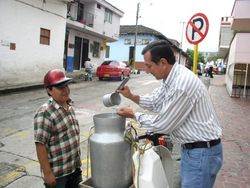 Selling milk in Colombia.