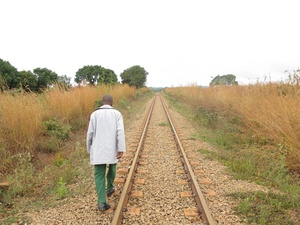 A member of the National Peasant's Union (UNAC) walking along the Nacala Corridor rail line, in Mecubúri District, Nampula Province, June 2012 (Photo: GRAIN)